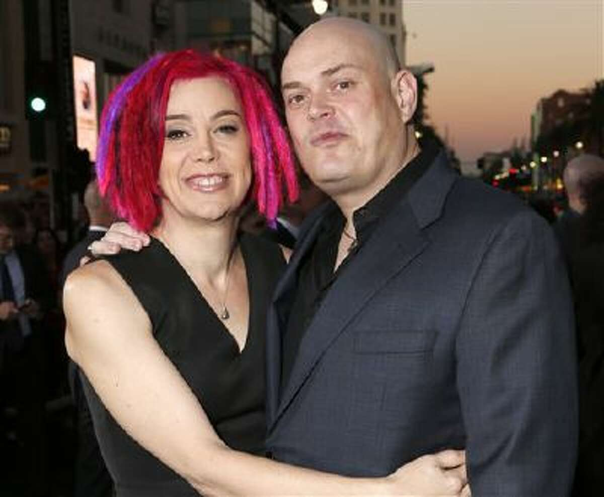 """In this Oct. 24, 2012, file photo, co-directors Lana Wachowski and Andy Wachowski pose for a photo at the Los Angeles premiere of """"Cloud Atlas"""" in Los Angeles. The Wachowski siblings say they?re hoping to again surprise audiences with the science-fiction movie ?Jupiter Ascending,? starring Channing Tatum and Mila Kunis. The Wachowskis said in an interview Thursday, Oct. 24, 2013, that they were overseeing editing and special effects for the movie set for release next summer."""