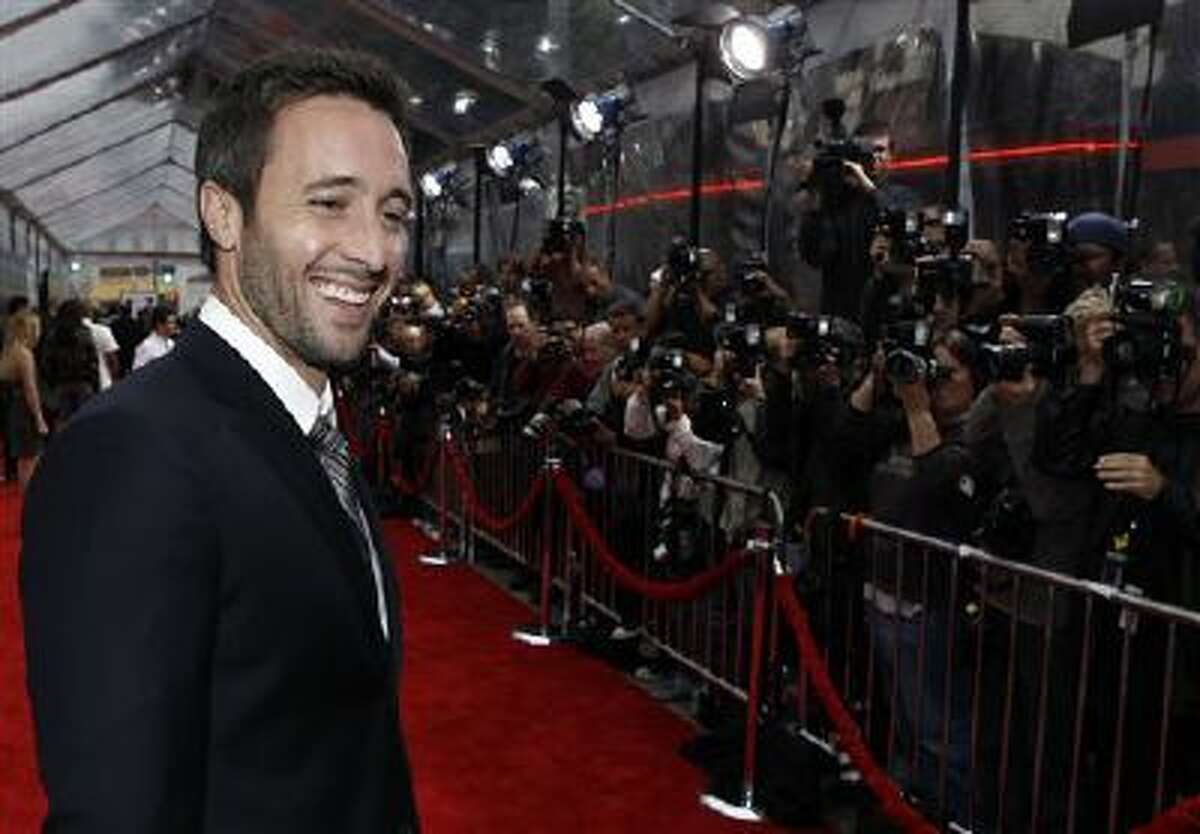 """In this Wednesday, April 21, 2010, file photo, cast member Alex O'Loughlin arrives at the premiere of """"The Back-up Plan"""" in Los Angeles. O?Loughlin says he?s signed up for two more seasons of ?Hawaii Five-0? but is looking forward to a career beyond the hit TV series."""