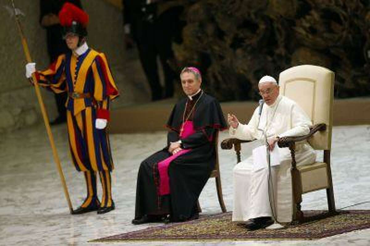 """Pope Francis speaks as he leads a meeting celebrating the """"Year of the faith"""" in Paul VI's hall at the Vatican July 6, 2013."""