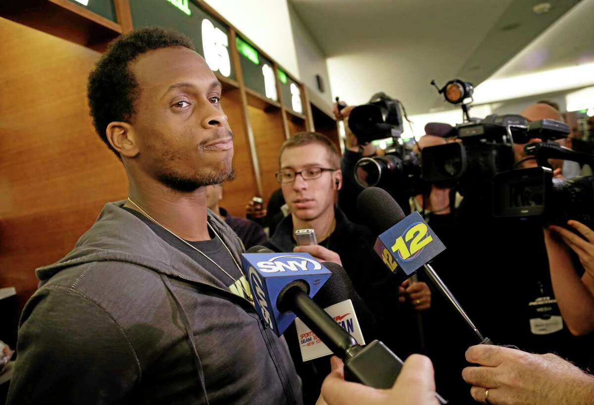 New York Jets' quarterback Geno Smith speaks to reporters in the locker room of the Jets training facility in Florham Park, N.J., on Monday.