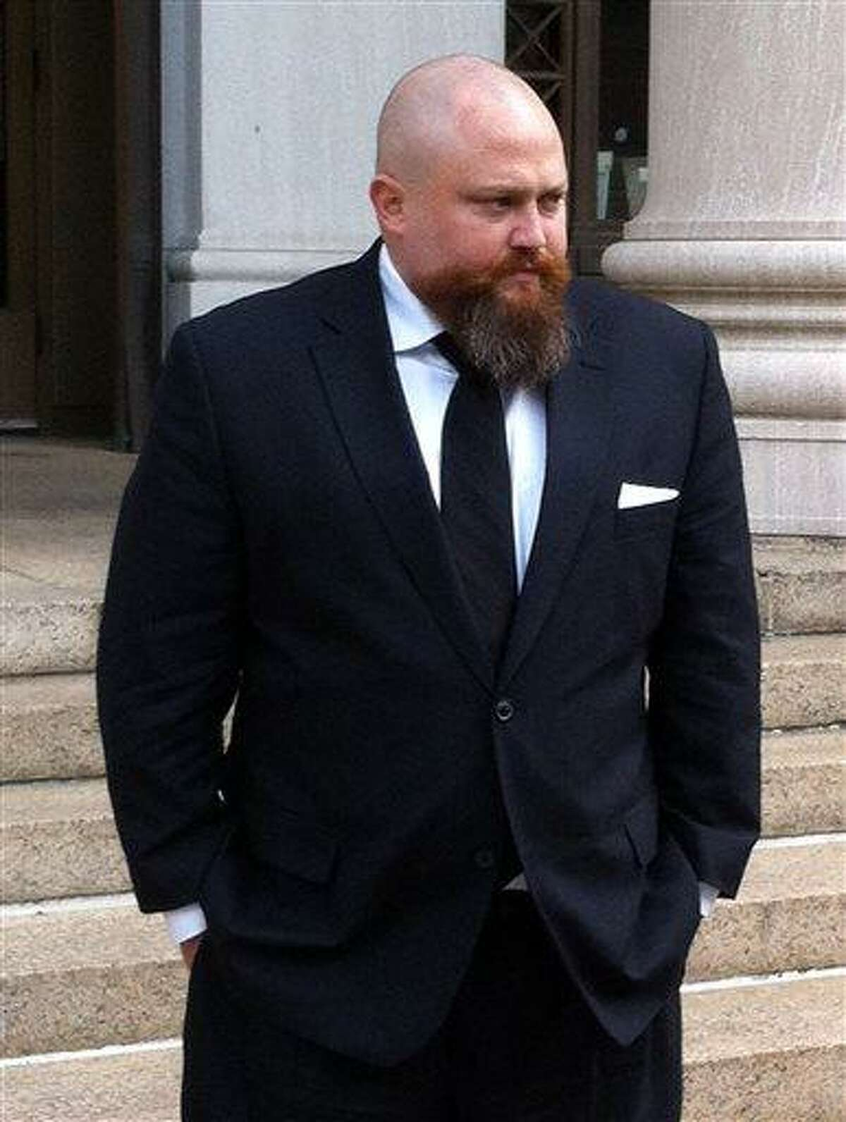Robert Braddock Jr. walks outside federal court in New Haven, Conn., Monday May 13, 2013. Braddock, the finance director for ex-Connecticut House Speaker's failed congressional campaign last year, is on trial on conspiracy and campaign finance charges. (AP Photo/David Collins)