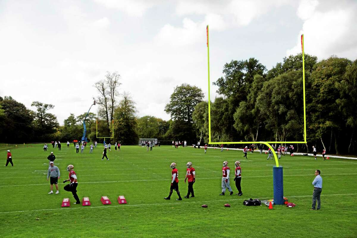 San Francisco 49ers players take part in practice at the Grove Hotel in Chandler's Cross, England, on Thursday. San Fran will play the Jacksonville Jaguars at Wembley stadium in London on Sunday.