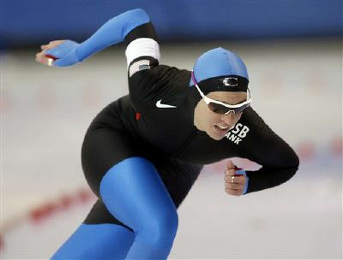 United States' Kelly Gunther skates to a second place finish in the women's 1,000-meter event at the US Olympic speedskating trials at the Utah Olympic Oval in Kearns, Utah, Wednesday, Dec. 30, 2009.
