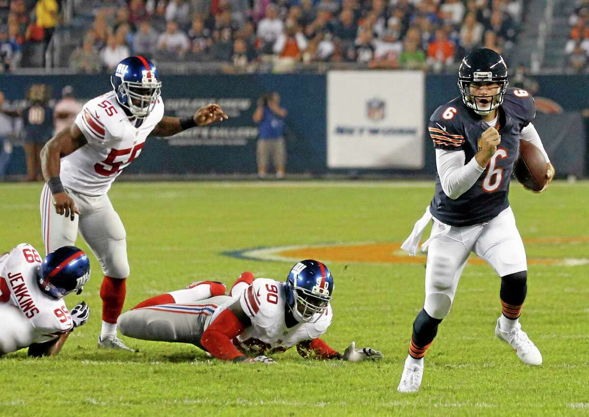 Chicago Bears quarterback Jay Cutler (6) scrambles past New York Giants defenders Cullen Jenkins (99), Keith Rivers (55) and Jason Pierre-Paul (90) on Oct. 10 in Chicago.