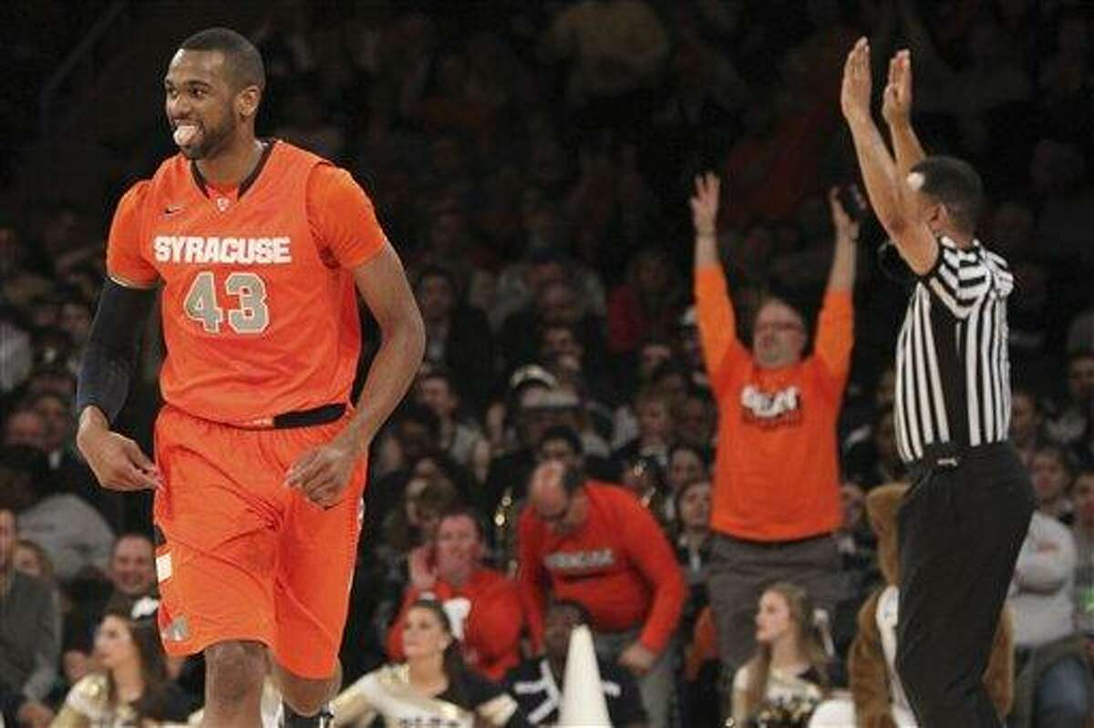 AP Photo/Mary Altaffer Syracuse's James Southerland reacts after scoring during the first half of an NCAA college basketball game against Pittsburgh at the Big East Conference tournament, Thursday, March 14, 2013 in New York.