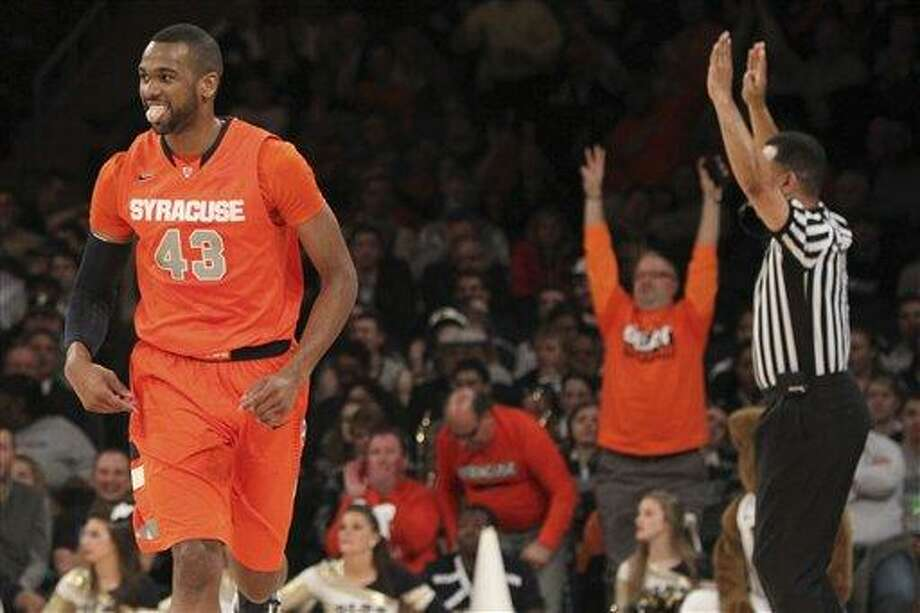 AP Photo/Mary Altaffer Syracuse's James Southerland reacts after scoring during the first half of an NCAA college basketball game against Pittsburgh at the Big East Conference tournament, Thursday, March 14, 2013 in New York. Photo: AP / AP