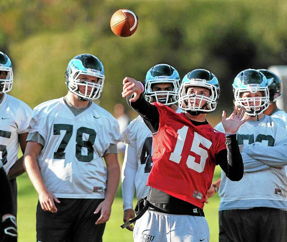 Quarterback Brandon Basil will be making his second start Friday night against New Haven. Photo: Peter Casolino — Register