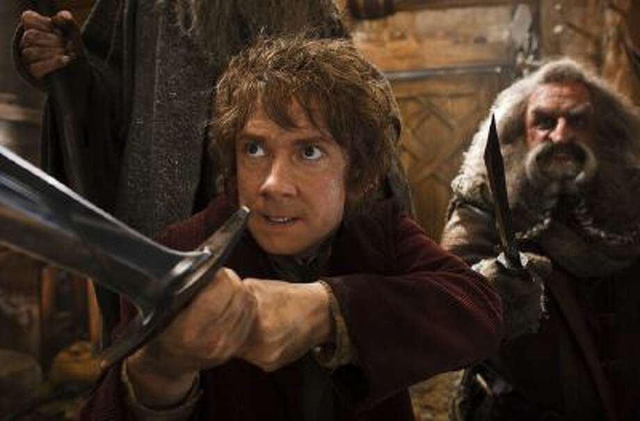 """This image released by Warner Bros. Pictures shows Martin Freeman, left, and John Callen in a scene from """"The Hobbit: The Desolation of Smaug."""""""