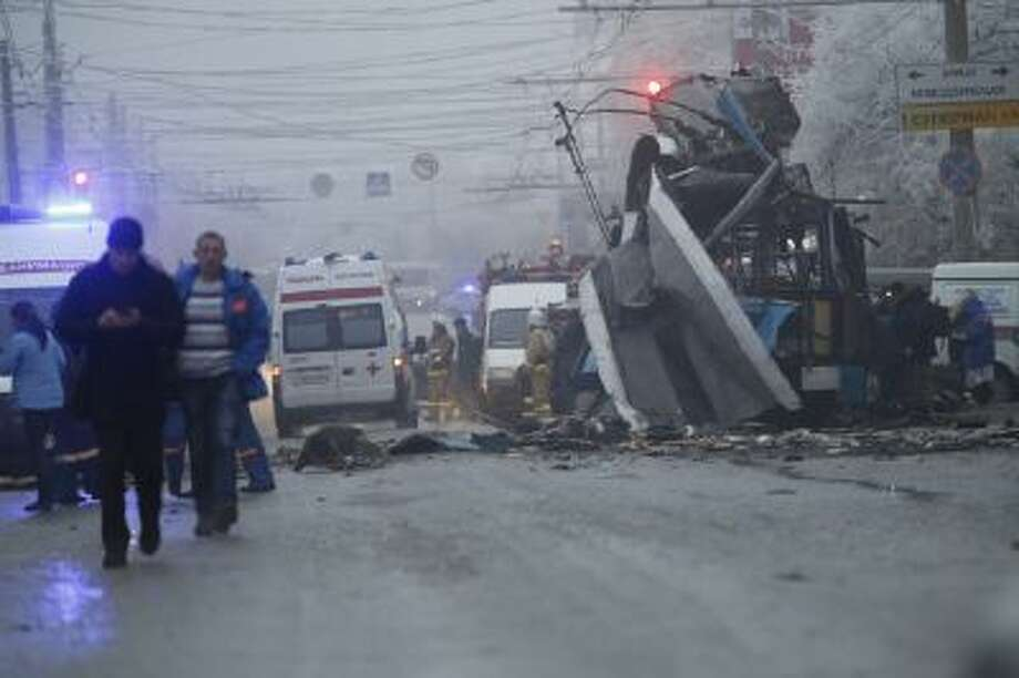 Ambulances line up a site of a trolleybus explosion in Volgograd, Russia, Monday