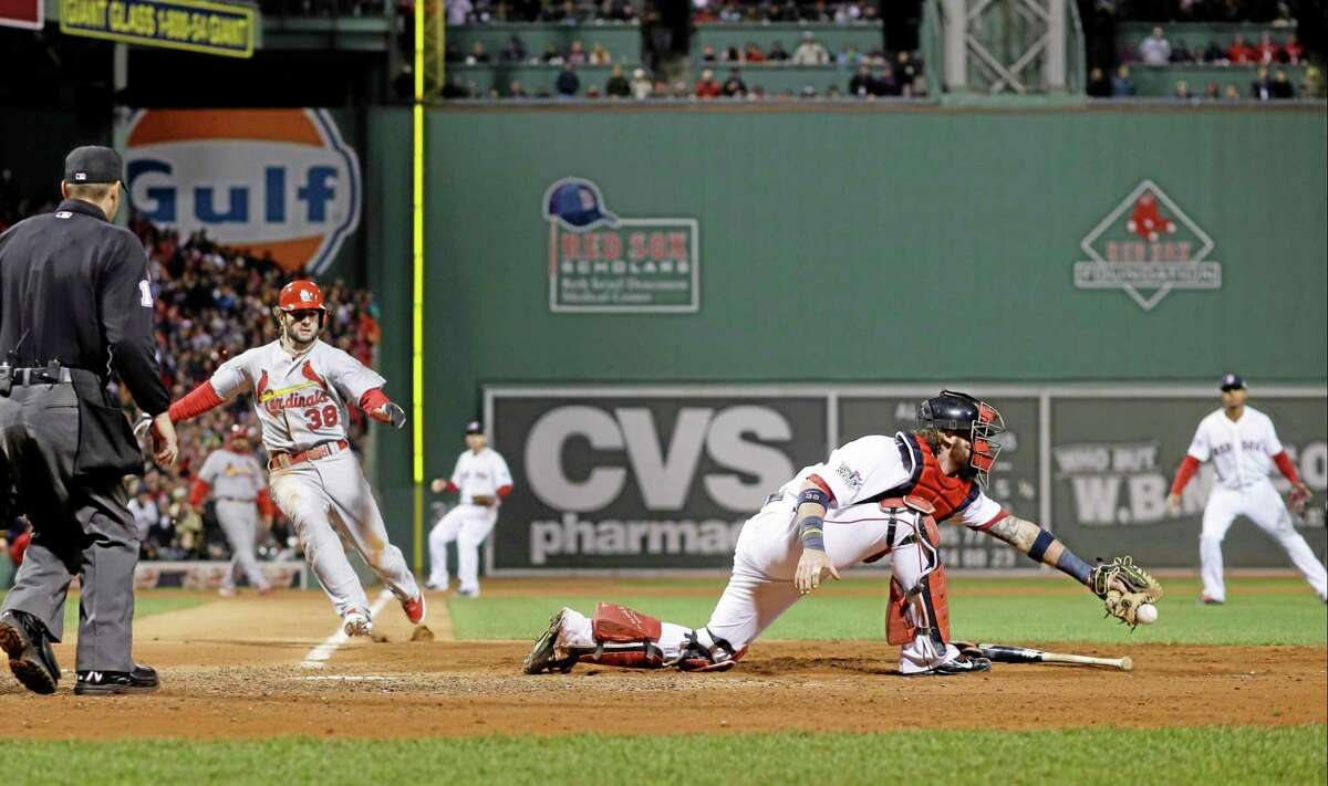 The Cardinals' Pete Kozma is safe at home as catcher Jarrod Saltalamacchia can't handle the throw during the seventh inning on Thursday.