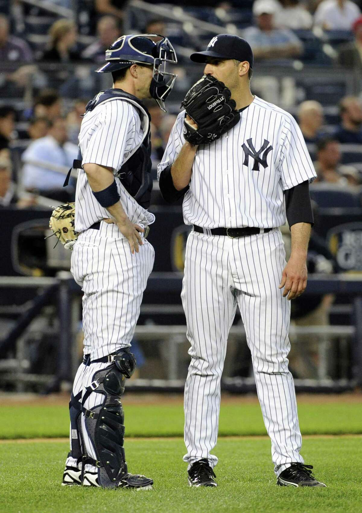 New York Yankees pitcher Andy Pettitte, right, talks with catcher Chris Stewart during the fourth inning of a baseball game against the Seattle Mariners Thursday, May 16, 2013, at Yankee Stadium in New York. (AP Photo/Bill Kostroun)
