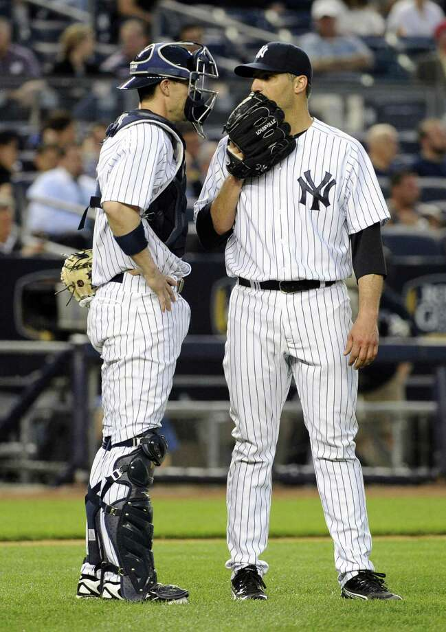 New York Yankees pitcher Andy Pettitte, right, talks with catcher Chris Stewart during the fourth inning of a baseball game against the Seattle Mariners Thursday, May 16, 2013, at Yankee Stadium in New York. (AP Photo/Bill Kostroun) Photo: ASSOCIATED PRESS / AP2013