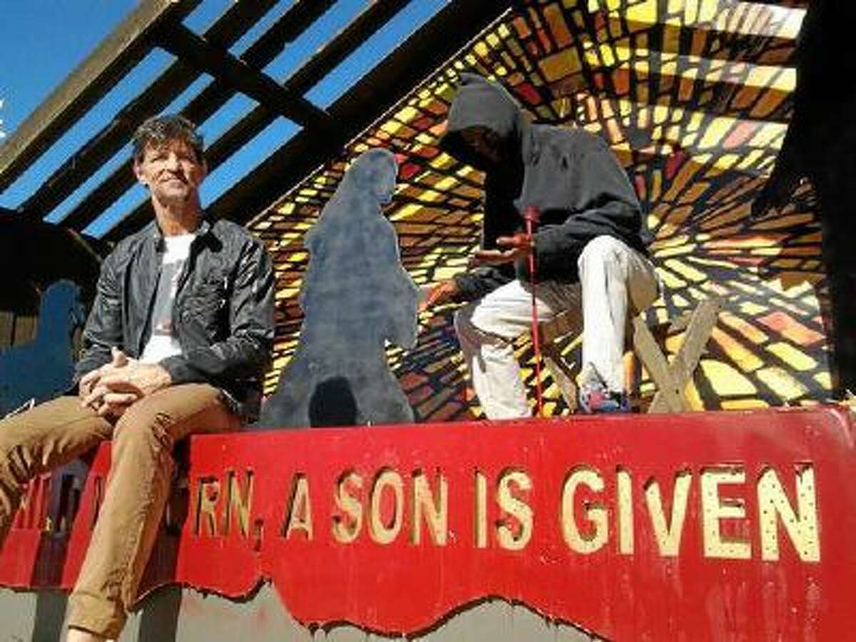John Zachary sits in front of the nativity scene he created that features Trayvon Martin.