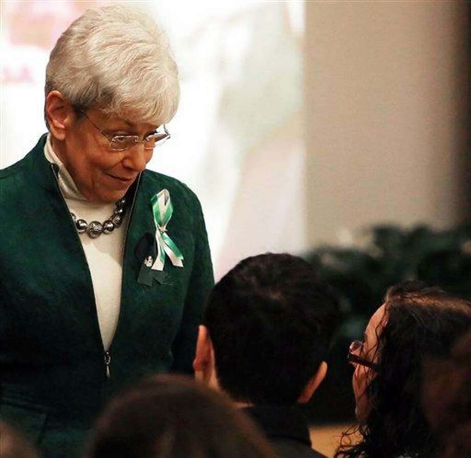 Conn. Lt. Governor Nancy Wyman speaks with Donna Soto mother of slain Sandy Hook Elementary School teacher Victoria Soto before a memorial to her daughter at Eastern Connecticut State University, Saturday March 9, 2013 in Willimantic, Conn  The university gathered to remember the 2008 graduate who sacrificed her life to save her students during the December 14, 2012 school shooting where twenty children and six adults were slain by Adam Lanza. Soto was remembered by friends, university staff and family as a dedicated student and a caring individual. (AP Photo/Journal Inquirer, Jared Ramsdell) Photo: AP / Journal Inquirer
