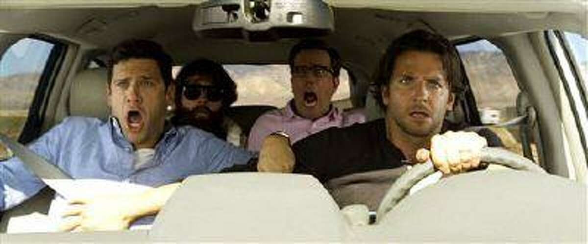 """This undated publicity photo shows, from left, Justin Bartha as Doug, Zach Galfianakis as Alan, Ed Helms as Stu and Bradley Cooper as Phil in Warner Bros. Pictures' and Legendary Pictures' comedy """"The Hangover Part III,"""" a Warner Bros. Pictures release."""