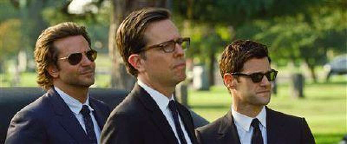 """This undated publicity photo shows, from left, Bradley Cooper as Phil, Ed Helms as Stu and Justin Bartha as Doug in Warner Bros. Pictures' and Legendary Pictures' comedy """"The Hangover Part III,"""" a Warner Bros. Pictures release."""