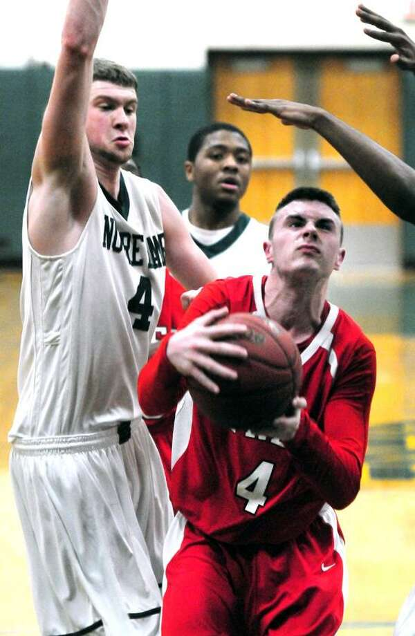 Ryan Murphy, right, and the Fairfield Prep basketball team will host top-ranked Hillhouse Tuesday night in a battle of SCC undefefeated teams. Photo by Arnold Gold/New Haven Register