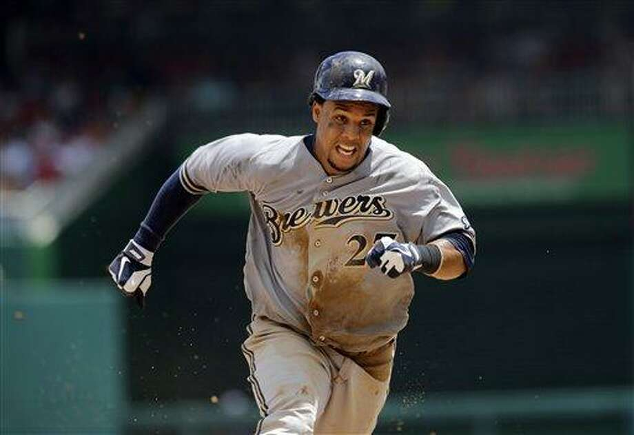Milwaukee Brewers center fielder Carlos Gome. (AP Photo/Mark Tenally) Photo: AP / FR170908 AP