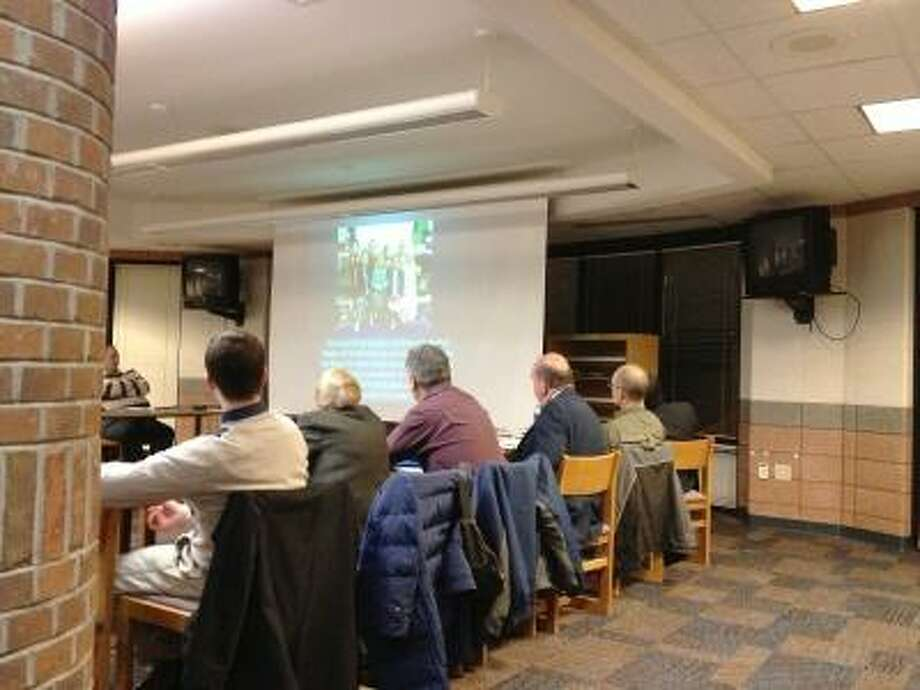 JASON SIEDZIK/ Register Citizen Region 10 Board of Education members take a look at an extensive presentation on the district's new all-day kindergarten program.