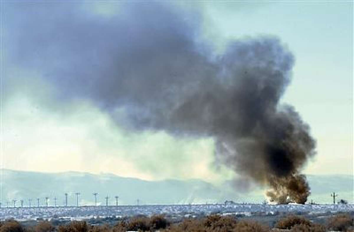 Smoke from the Bango Refining oil plant explosion Dec. 9 can be seen along U.S. 50 alternate between Fernley and Fallon, Nev. The fire critically injured a 24-year-old refinery worker.