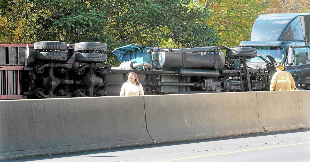 (Mara Lavitt — New Haven Register) October 24, 2013 GuilfordA tractor-trailer flipped in its side stopped traffic on I-95 northbound in Guilford.