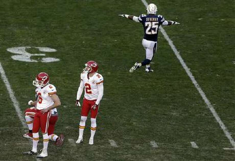 Kansas City Chiefs kicker Ryan Succop, left, looks down after missing a field goal during the last minute of regulation time as San Diego Chargers defensive back Darrell Stuckey, right, reacts during the second half in an NFL football game, Sunday, Dec. 29, 2013, in San Diego. Photo: AP / AP