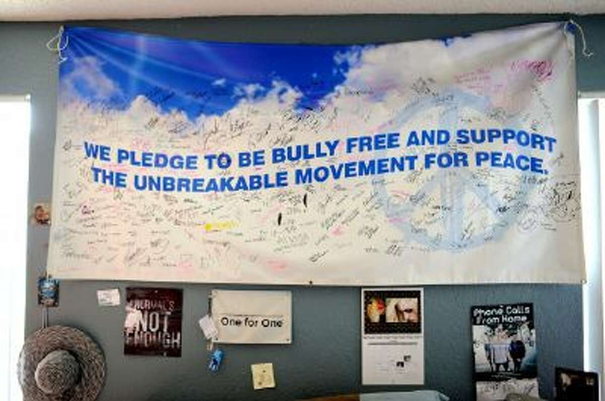 A banner for the Unbreakable Movement sits on the wall above Sarah Ball's bed at her home on Wednesday, Oct. 23, 2013 in Spring Hill, Fla. Ball, a victim of cyber bullying during her high school years, founded the Unbreakable Movement, an anti-bullying group that started at her high school and appears to spreading throughout Florida.