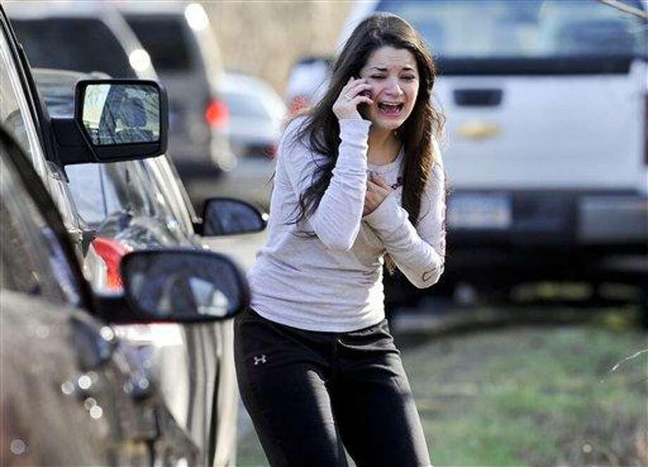 FILE - In this Dec. 14, 2012, file photo, Carlee Soto reacts as she learns her sister, Victoria Soto, a teacher at the Sandy Hook Elementary School, was one of 26 people killed in a shooting at the school in Newtown, Conn. Absent a magic potion or explosive economic growth, it was all but inevitable President Barack Obama would have to break some of his campaign promises to keep others, because of their incompatibility. In recent years, America has had many scenes of mass shootings. The campus of Virginia Tech University. A shopping center in Tucson, Ariz. A movie theater in Aurora, Colo. A temple in Oak Creek, Wisc. None put gun control back on the national agenda in a serious way. Then came the elementary school massacre in Newtown, Conn., after the election, and that all changed. Or so it seemed. (AP Photo/Jessica Hill, File) Photo: AP / FR125654 AP