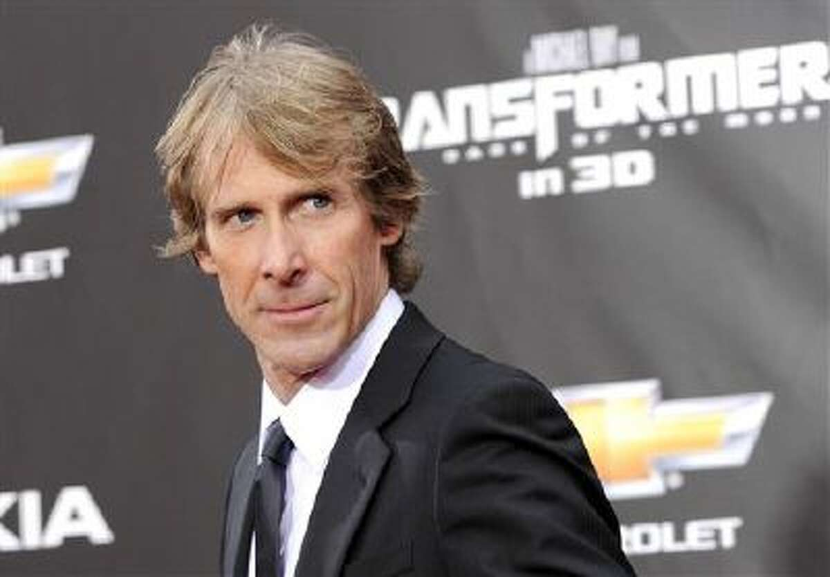 """In this June 28, 2011 file photo, executive producer and director Michael Bay attends the """"Transformers: Dark Of The Moon"""" premiere in Times Square in New York."""