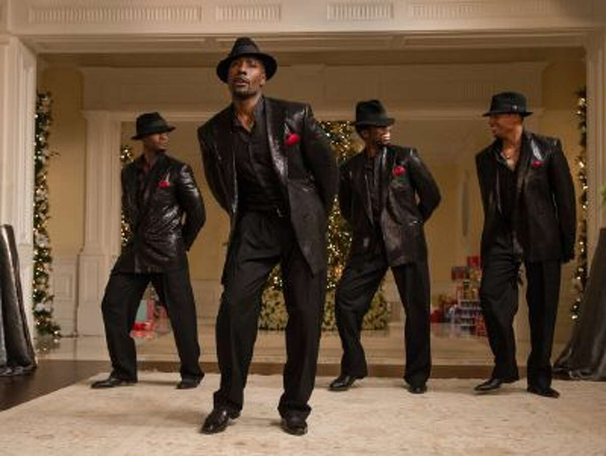 """This image released by Universal Pictures shows, from left, Taye Diggs, Morris Chestnut, Harold Perrineau and Terrence Howard in a scene from """"The Best Man Holiday."""""""