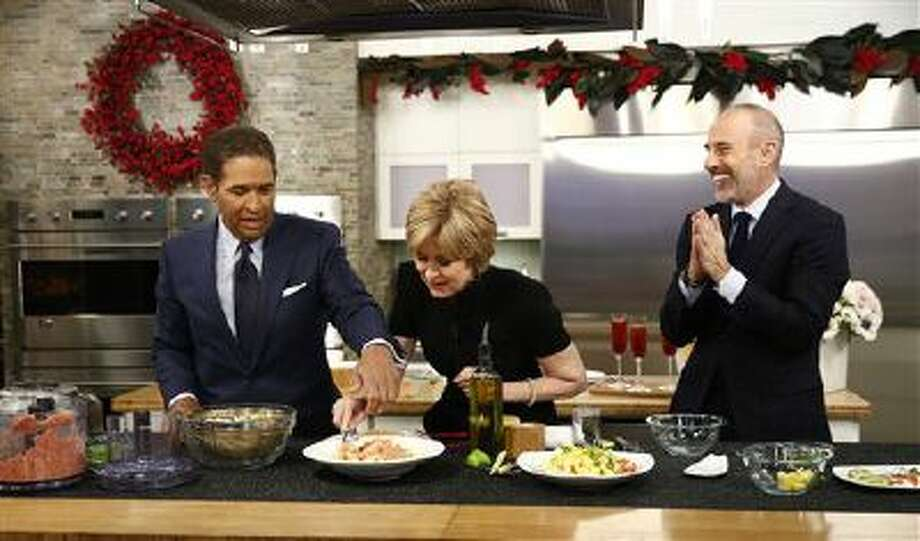 """This image released by NBC shows, from left, guest hosts, Bryant Gumbel and Jane Pauley, with host Matt Lauer during a cooking segment on NBC News' """"Today"""" show, Monday, Dec. 30, 2013 in New York. Gumbel and Pauley, who worked together on ?Today? from 1982 to 1989, joined Matt Lauer to co-host on Monday, filling in for Savannah Guthrie and Natalie Morales who were off. Photo: AP / NBC"""