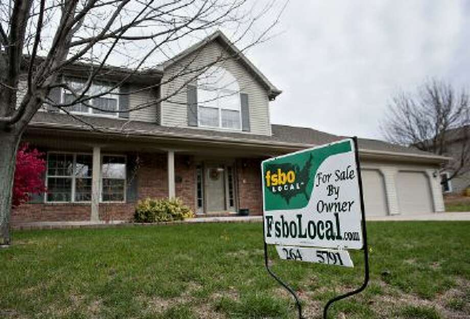 "A ""For Sale By Owner"" sign stands outside of a home in Peoria, Illinois, U.S., on Thursday, Oct. 18, 2012. Photo: Bloomberg Via Getty Images / 2012 Bloomberg"