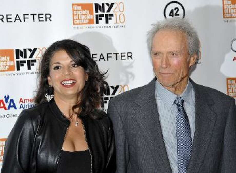 """In this Oct. 10, 2010 file photo, director and producer Clint Eastwood, right, and wife Dina Eastwood attend the premiere of """"Hereafter"""" at Alice Tully Hall during the 48th New York Film Festival, in New York."""