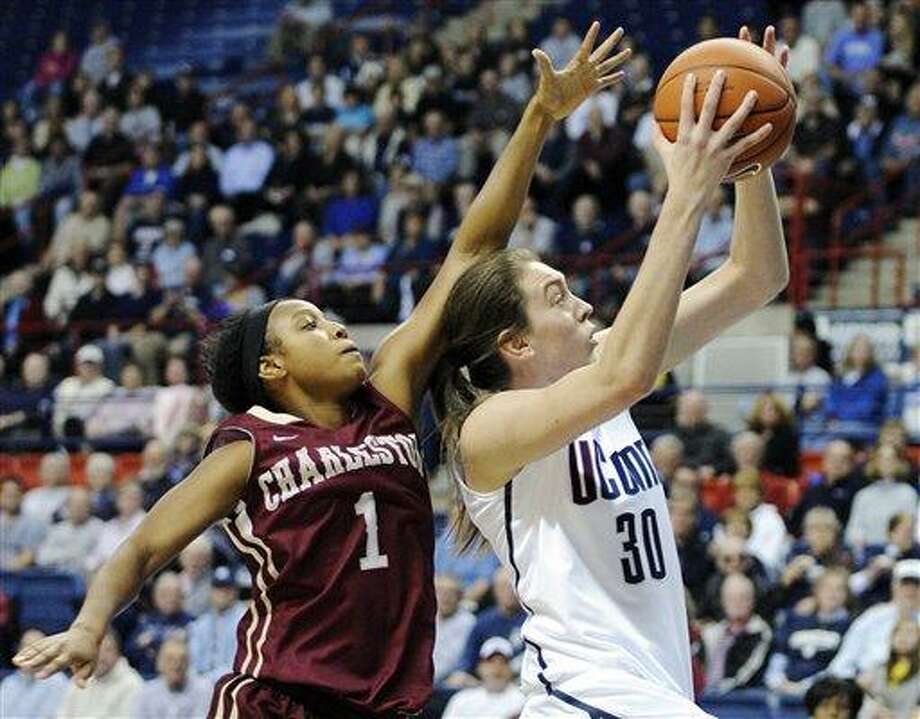 Connecticut's Breanna Stewart (3) drives past Charleston's Alyssa Frye during the first half of an NCAA college basketball game in Storrs, Conn., Sunday, Nov. 11, 2012. (AP Photo/Fred Beckham) Photo: AP / FR153656 AP