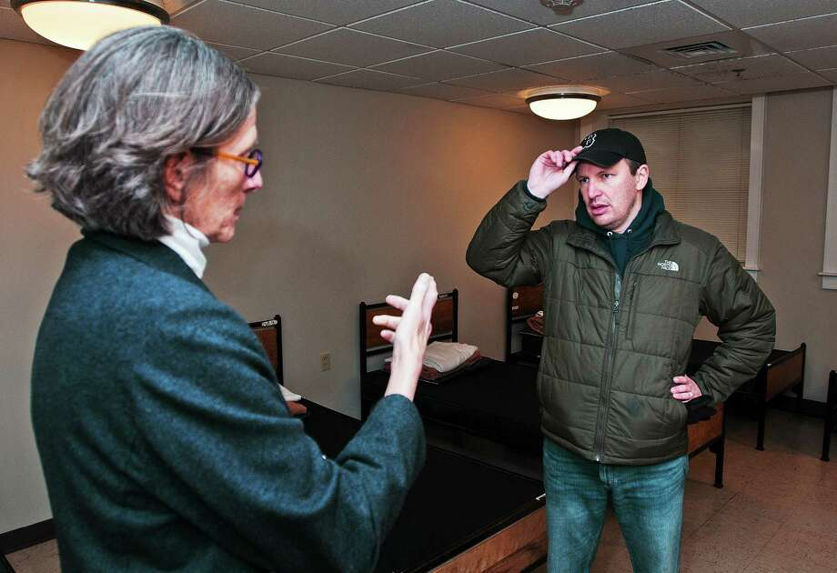 (Peter Casolino ó New Haven Register)   Senator Chris Murphy talks with Alison Cunningham, executive director of the Columbus House as Murphy spent the day with a New Haven homeless man. Murphy followed the man for an entire day, seeing what the homeless go through to survive. He was at the Columbus house, where the man was sleeping at night.  pcasolino@NewHavenRegister Photo: Journal Register Co.