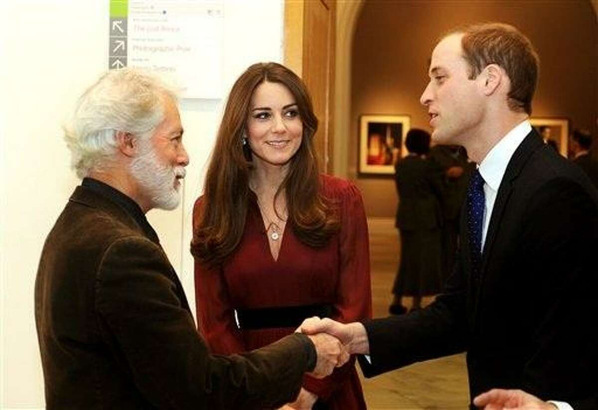 The Duke and Duchess of Cambridge meet artist Paul Emsley after viewing the newly-commissioned portrait of The Duchess of Cambridge at the National Portrait Gallery in central London, Friday. AP Photo/PA, John Stillwell