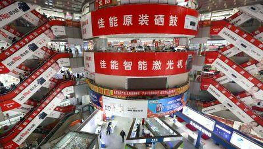 Canon inc. advertisements are displayed inside a shopping mall in Beijing, China, on Wednesday, March 6, 2013.