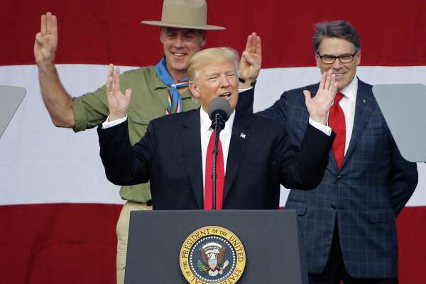 President DonaldTrump, front left, gestures as former boys scouts, Interior Secretary Ryan Zinke, left, Energy Secretary Rick Perry, watch at the 2017 National Boy Scout Jamboree at the Summit in Glen Jean,W. Va., Monday, July 24, 2017.