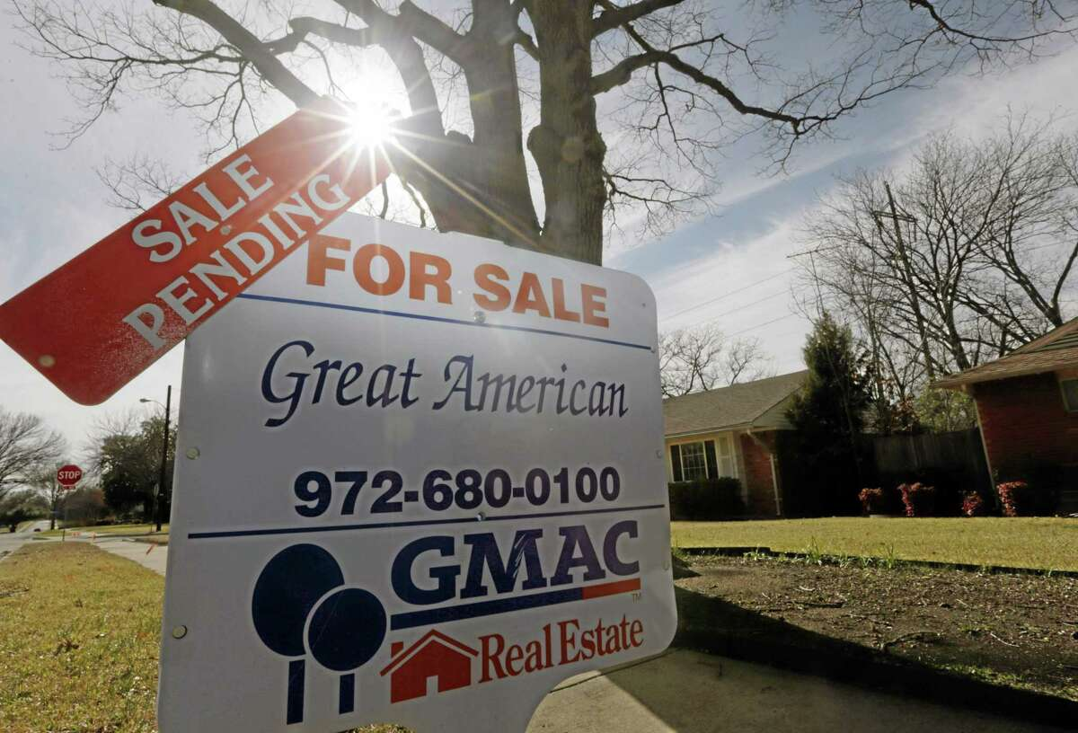 FILE - In this Friday, Feb. 22, 2013 file photo, a sale pending announcement sits atop a for sale sign in a home's yard in Richardson, Texas. National Association of Realtors releases pending home sales index for November on Monday, Dec. 30, 2013. (AP Photo/LM Otero, File)
