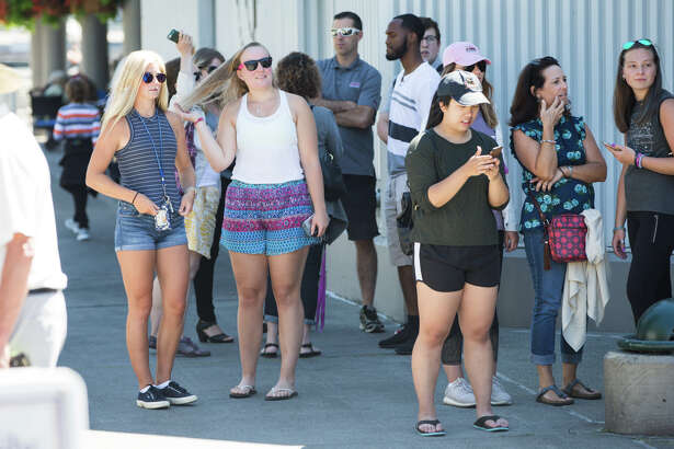 Grey's Anatomy fans wait next to Pier 66 in hopes of seeing actors on Tuesday, July 25, 2017.