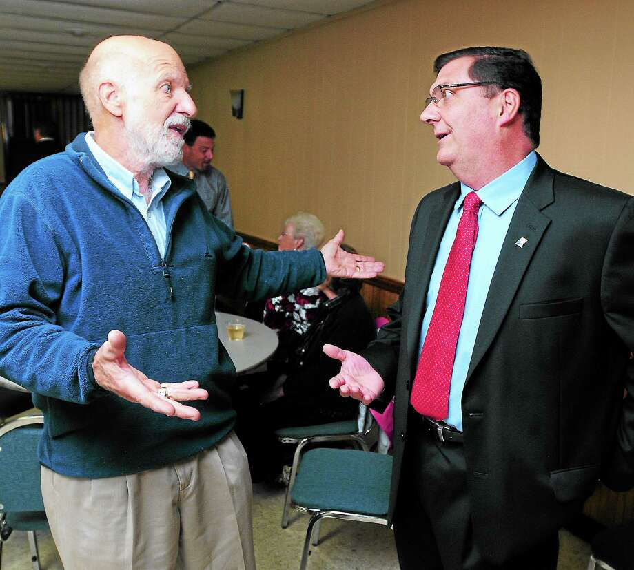 (ARNOLD GOLD — REGISTER)  Mark Maxim, left, president of the West Shore Taxpayers Association, talks with West Haven Democratic mayoral candidate Edward O'Brien at the Italian-American Club on Wednesday. Photo: Journal Register Co.
