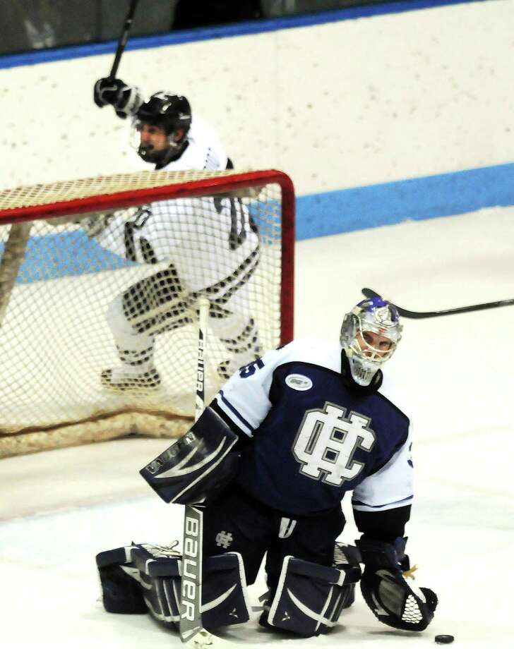 Yale's Jesse Root celebrates a goal by Kenny Agostino behind Holy Cross goalie Matt Ginn during Sunday's game at Ingalls Rink. Photo: Mara Lavitt — Register   / Mara Lavitt