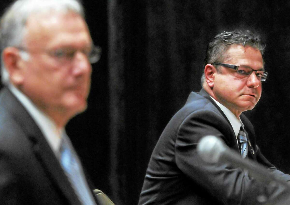 Ansonia Mayor James Della Volpe, left, and his Republican challenger David Cassetti listen to questions during a debate Thursday night at Ansonia High School.