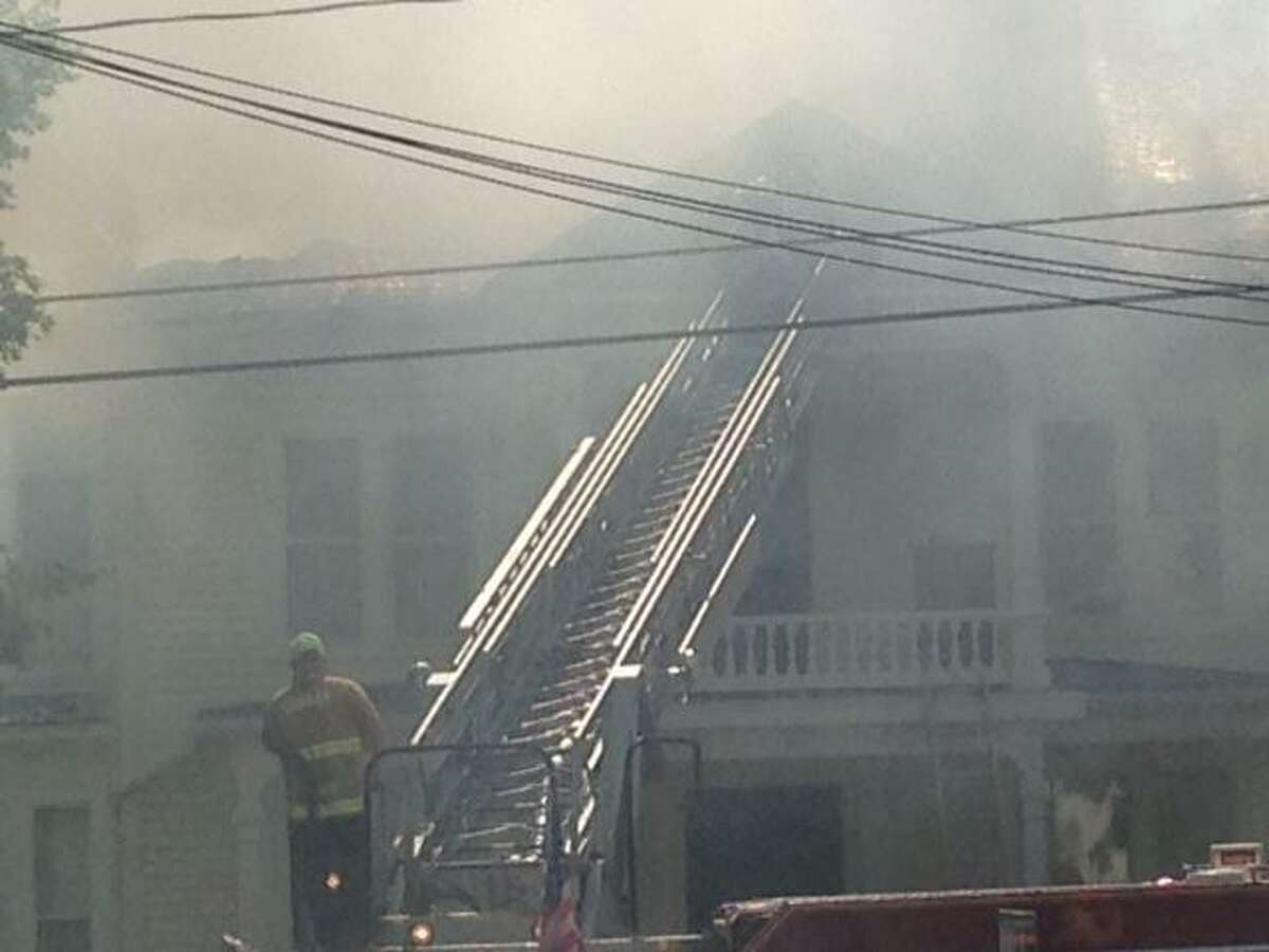 Firefighters battle a house fire on Prospect Street in Falls Village. Jay Schall/Contributed photo.