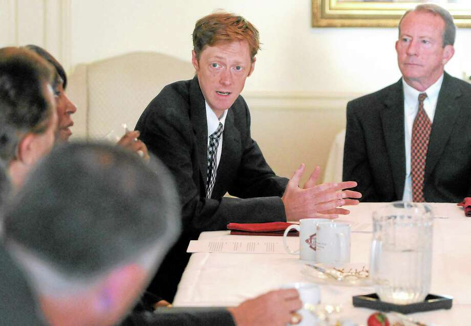 New Haven Mayoral candidate Justin Elicker, left, answers questions from members of the Regional Leadership Council Thursday morning at the Quinnipiack Club in New Haven. Photo: Peter Hvizdak — New Haven Register   / ©Peter Hvizdak /  New Haven Register