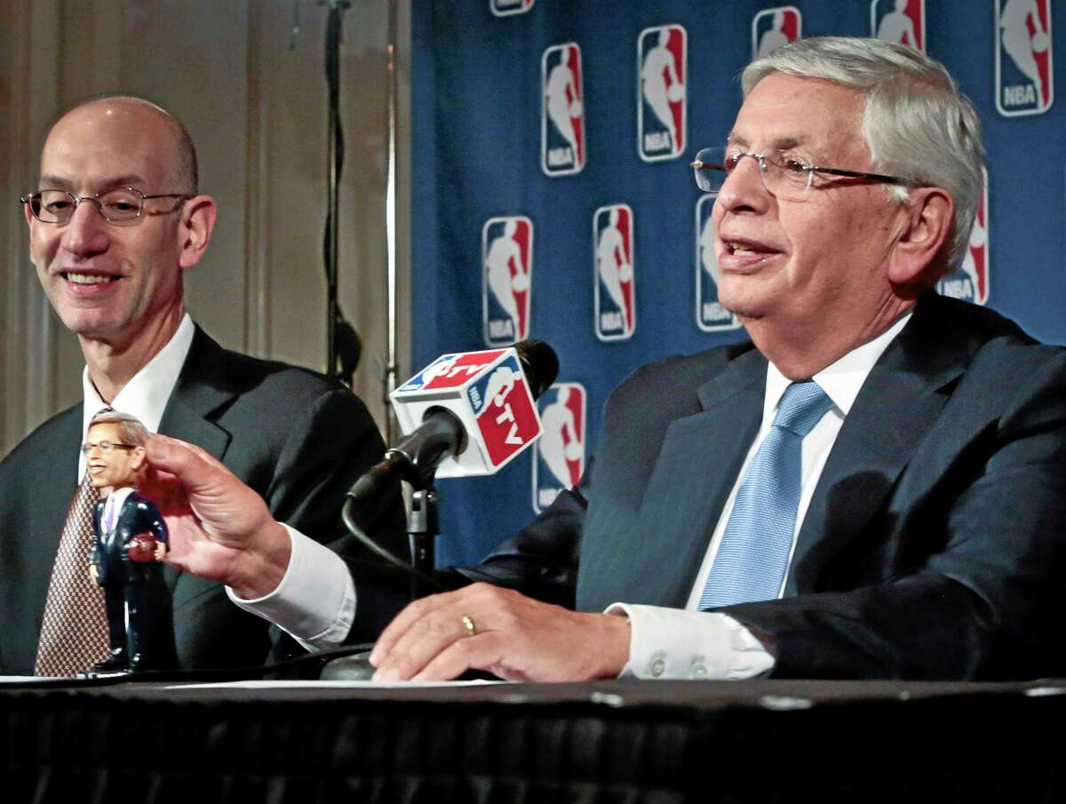 NBA deputy commissioner Adam Silver, left, smiles as NBA commissioner David Stern shows a bobblehead doll in his likeness during a press conference after a meeting of the NBA board of governors on Wednesday in New York. Stern will formally step aside Feb. 1 after 30 years and Silver will become the new commissioner.