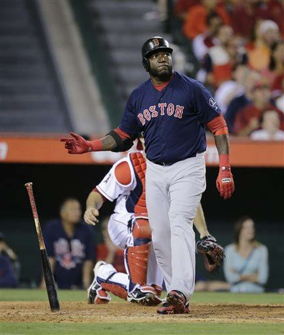 Boston Red Sox's David Ortiz watches the flight of his two-run home run during the eighth inning of a baseball game against the Los Angeles Angels in Anaheim, Calif., Friday, July 5, 2013. (AP Photo/Jae C. Hong)