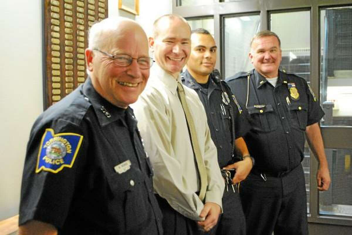 Jessica Glenza-Register Citizen - Officer Mike Morris, new recruit Mathew Richard, Officer Ricardo Toledo, and Lt. Bruce Whiteley stand in the Torrington Police Department station house. Morris and Whiteley are eligible to retire, Richard and Toledo are two of the force's new recruits.
