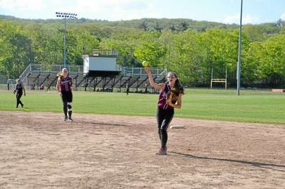 Pete Paguaga/Register Citizen  Second baseman Nikki Jamieson throws out a runner at first base.