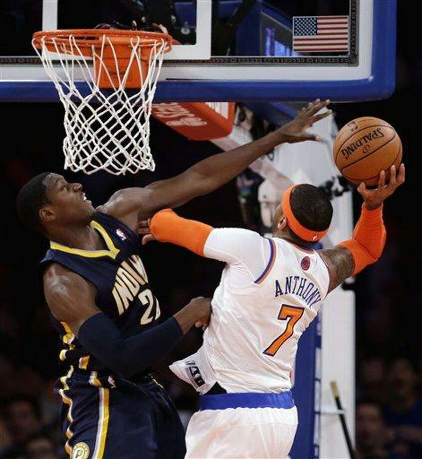 New York Knicks' Carmelo Anthony, right, goes up for a shot against Indiana Pacers' Paul George in the first half of Game 5 of an Eastern Conference semifinal in the NBA basketball playoffs, at Madison Square Garden in New York, Thursday, May 16, 2013. (AP Photo/Julio Cortez) Photo: ASSOCIATED PRESS / AP2013